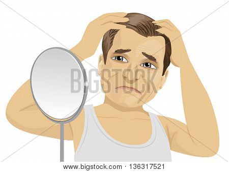 Mature man looking in a mirror worried about hair loss