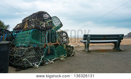 Lobster pots stacked ontop of each other near Bude on the Cornwall coast