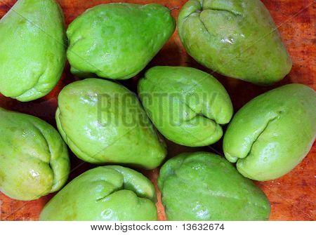 chayote mango fruit squash mirliton vegetable in orange background poster