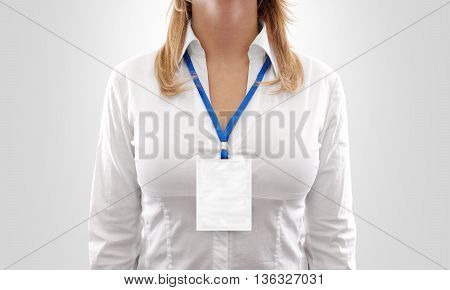 Woman wear big blank white vertical badge mockup, stand isolated. Name tag on neck and chest. Person identity label. Women in shirt uniform with empty id card mock up. Bussinesswoman lanyard design.