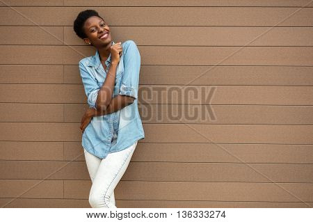 Black Woman On A Wooden Background