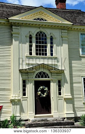 Canterbury Connecticut - July 11 2015: Georgian entrance door and east front of the 18th century Prudence Crandall House with second story Palladian window