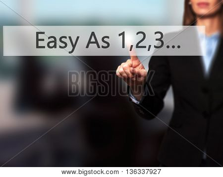Easy As 1,2,3... - Businesswoman Hand Pressing Button On Touch Screen Interface.