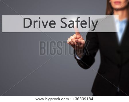 Drive Safely  - Businesswoman Hand Pressing Button On Touch Screen Interface.