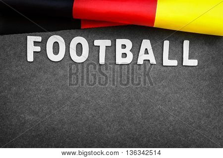 Gray background with word football and German flag on it, abstract football backdrop with text space, victory of the Germany team  on the European Football Championship, score board