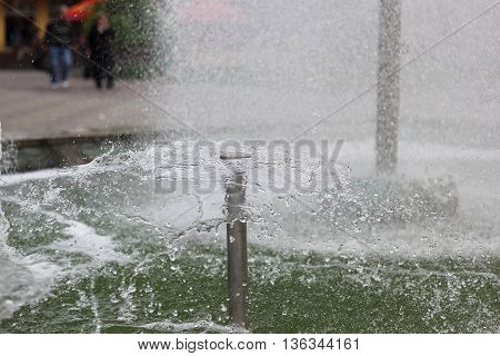 Streams of fountain jet water circular summer
