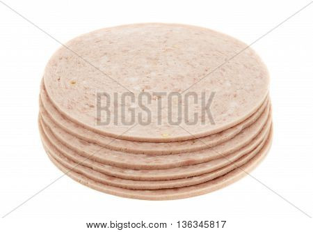 Round slices of pork meat on a white background