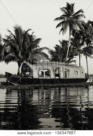 Peaceful Houseboat Traveling Backwater Concept