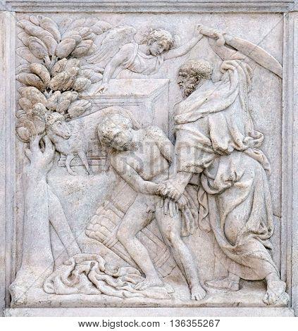 BOLOGNA, ITALY - JUNE 04: Abraham Sacrificing Isaac, relief on portal of Saint Petronius Basilica in Bologna, Italy, on June 04, 2015