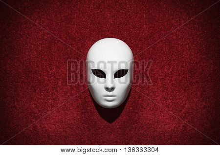 Mask on red carpet wall. Venice carnival. Copy space
