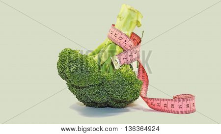 Green single Broccoli on white background with centimeter