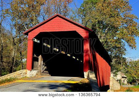 Goodville Pennsylvania - October 19 2015: Single span double Burr arch truss 1859 Pool Forge Covered Bridge over the Conestoga River
