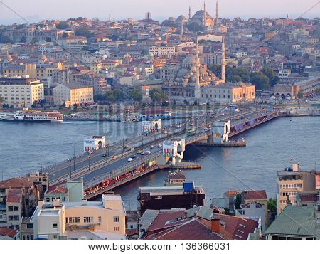ISTANBUL TURKEY - JULY 26: Galata Bridge in Istanbul on JULY 26 2006. Aerial Cityscape With Galata Bridge Over Golden Horn in Istanbul Turkey.