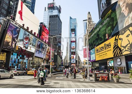 New York, USA - June 18, 2016: Times Square during the day with advertisements for the Lion King musical and stores such as Forever 21 and H&M