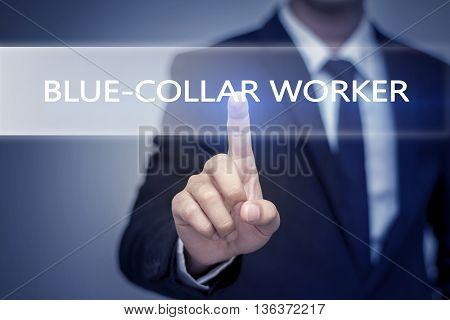 Businessman hand touching BLUE-COLLAR WORKER button on virtual screen