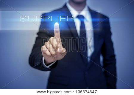 Businessman hand touching SUPPLIER button on virtual screen