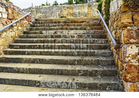 Old stairs in the littoral town where you can see the effect of salt in the air.