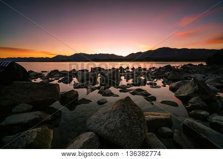 Scenic sunrise at Lake Tekapo in the glacier valley in Canterbury, New Zealand during autumn.