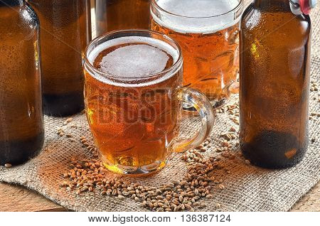 Wheat beer in old mugs on wooden table