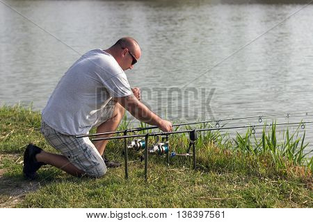 Man fishing at lake, Carp fishing, Angler
