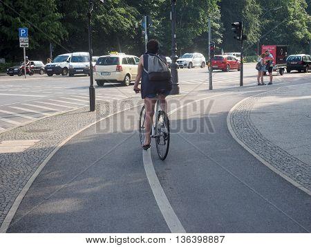 Woman On Bike Lane In Berlin