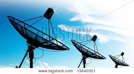 the satellite dish antennas under blue sky