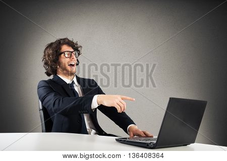 Businessman laughing looking at the computer table