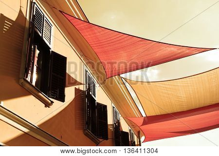 Street decorated with colored canvas awnings