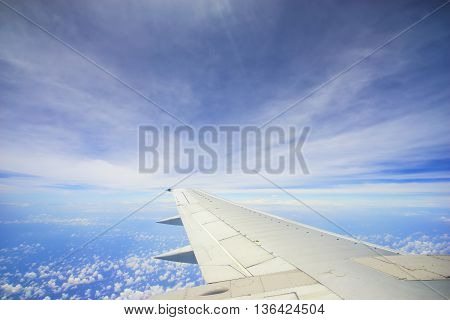 Unic cloud formation with blue sky view from flight windows with copyspace area.