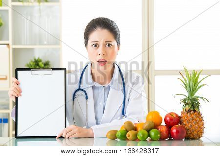 Doctor Nutritionist With Fruits And Holding Blank Clipboard Fell Fear