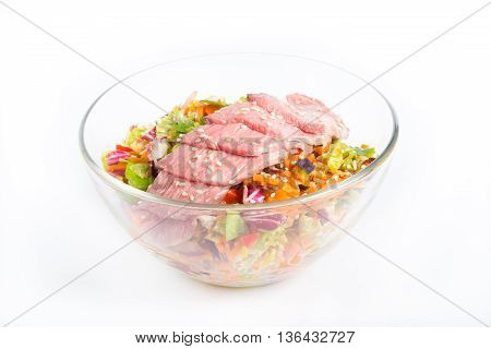 Roastbeef salad in a bowl on a white background