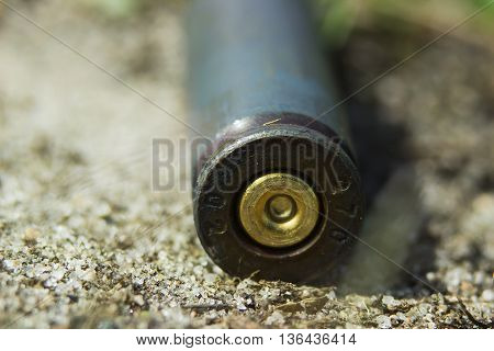 Macro Kalashnikov Gun Shell On The Sand