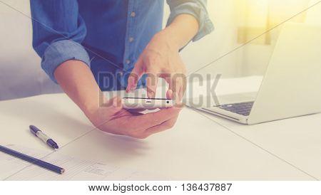Businessman Or Businesswoman Holding Mobile Phone About Research Data On Internet For Discuss Busine