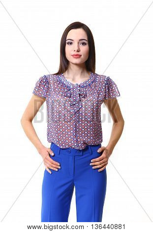 woman with straight hair style in sheer short sleeve blosue blue trousers close up photo