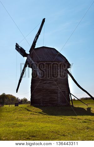 Landcape with old windmill in the village Pirogovo, Ukraine. Eastern Europe.