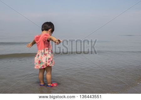 The girl was glad to see the sea.