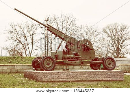Anti-aircraft machine gun of the World war II. War industry. Biggest war campaign of 20th century. Yellow photo filter. Weapons theme. Exposed artillery.