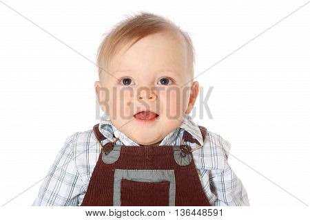 close-up portrait of a smiling kid in brown jumpsuite, looking directly, white background, isolated