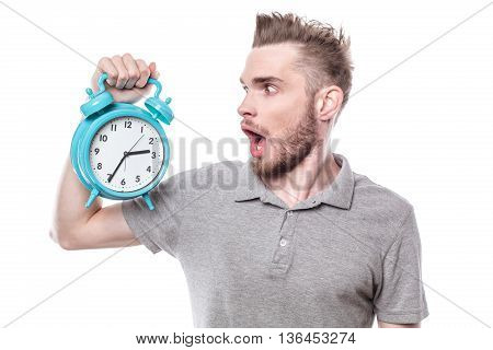 Funny concept for man with windblown mouth. Man holding alarm clock. Isolated on white background