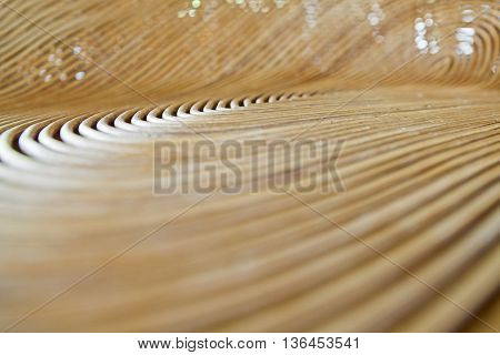 Cane or wickerwork background- showing the details of interlaced weave structure of basket or furnitureAbstract background from natural rattan. Handmade weaving.