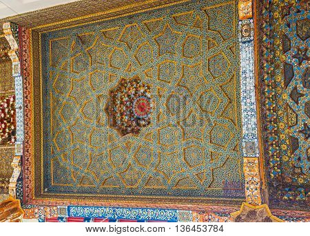 BUKHARA UZBEKISTAN - APRIL 29 2015: The multi-faceted stars prevail in the ceiling pattern in Sheikh Nakshbund Mausoleum on April 29 in Bukhara.