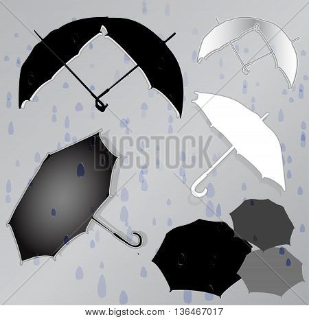 Silhouettes of umbrellas in the background of raindrops