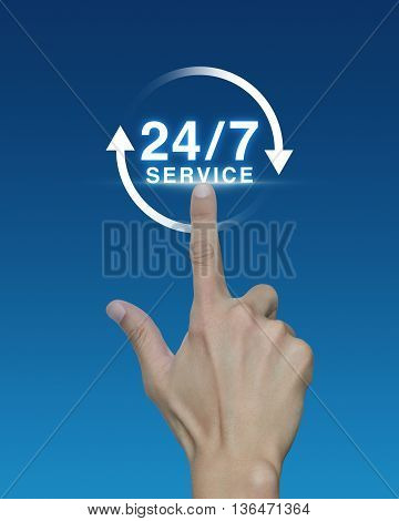 Hand pressing button 24 hours service icon on blue background Full time service concept