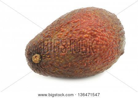 Eat ripe avocado on a white background