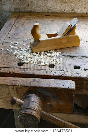 Planer In An Antique Wooden Workbench With Vise Inside The Craft