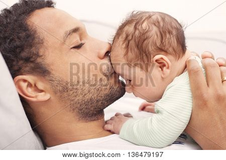 Interracial Father and interracial child spending time together