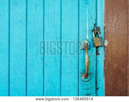Handle and master key lock blue wooden door.