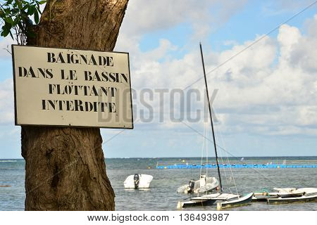 Le Vauclin France - november 13 2015 : bathing in the floating basin is forbidden wrote on a sign