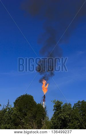 Fossil fuel burning combustion. Flames from associated gas burn off at oil power station.