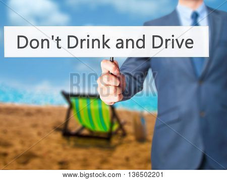 Don't Drink And Drive - Businessman Hand Holding Sign